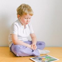 boy-in-white-polo-shirt-sitting-iPad